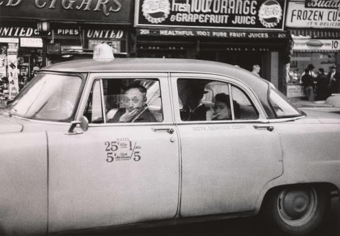 Diane Arbus. Taxicab driver at the wheel with two passengers, N.Y.C. 1956 © The Estate of Diane Arbus, LLC
