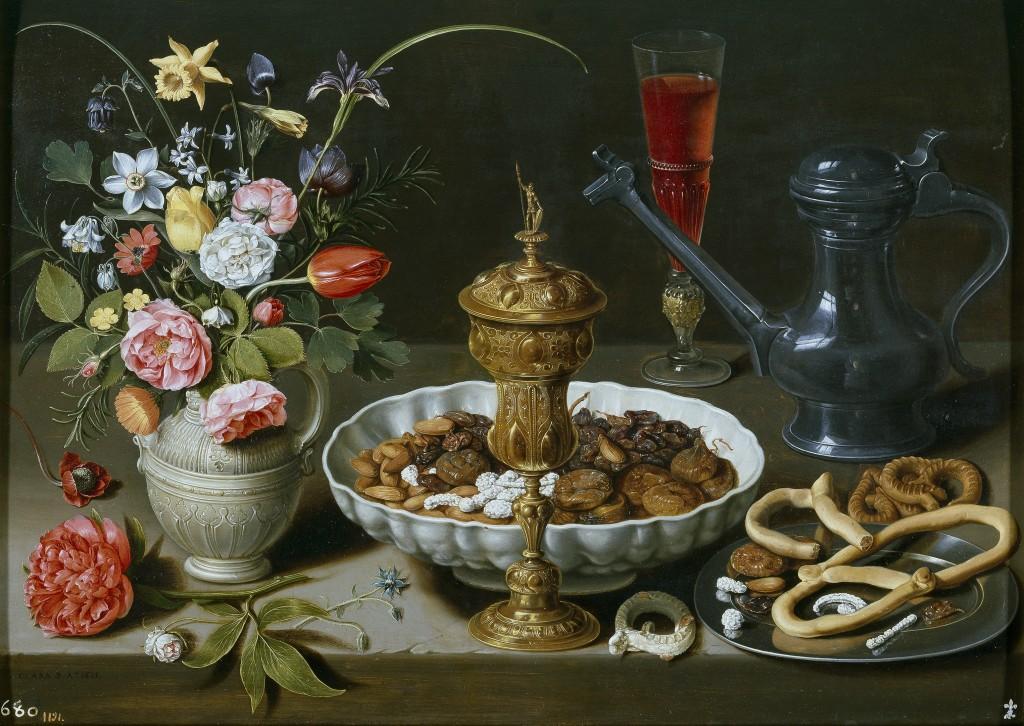 Clara Peeters. Bodegón con flores, copa de plata dorada, almendras, frutos secos, dulces, panecillos, vino y jarra de peltre, 1611. Museo Nacional del Prado