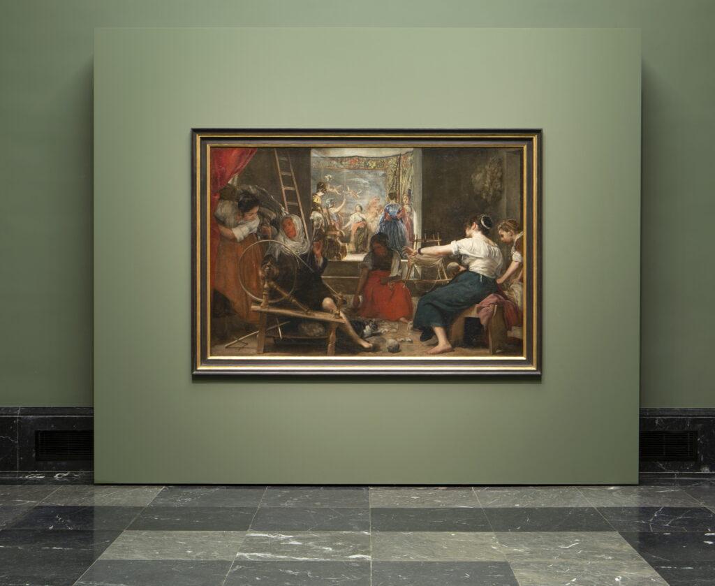 Imagen de Las hilanderas de Velázquez con el nuevo enmarcado Foto © Museo Nacional del Prado.