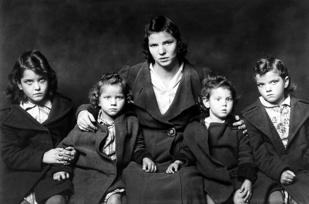 Mike Disfarmer. Untitled, (sad mother with four girls), 1939-46
