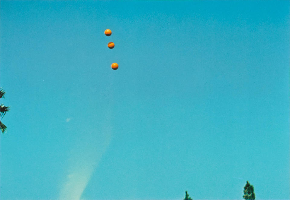 John Baldessari. Throwing three balls in the air to get a straight line, 1973