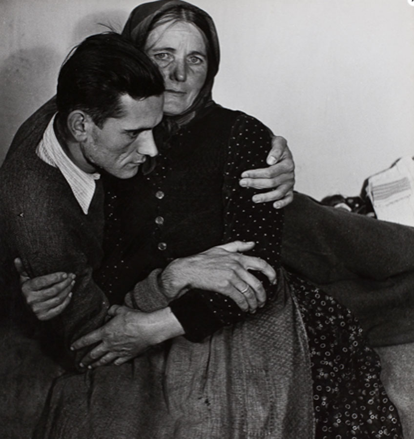 Madame d´Ora. Woman supporting a sickly man at a displaced persons camp in Austria, 1948